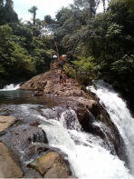 Jumping at kembar waterfalls during do Trekking and Hiking Tour with Bali Jungle Trekking Team Guide