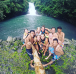 take-a-picture-at-the-front-of-waterfalls-sambangan-trekking-with-local-guide